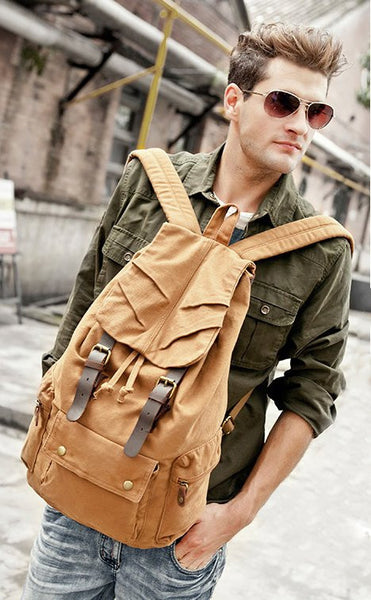 sexy man wearing light brown military canvas backpack