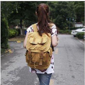 Woman wearing unisex Serbags light-brown military travel backpack