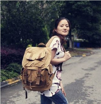 Young traveller sporting the Serbags light-brown military travel backpack