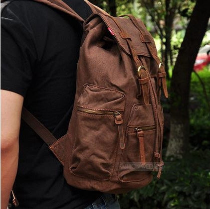 Boy wearing the Serbags sturdy dark brown vintage hiking backpack