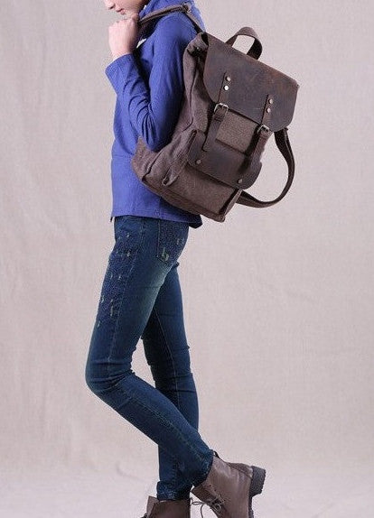 Woman sporting dark brown travel vintage & canvas backpack