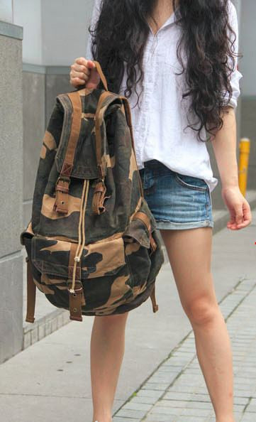 Young woman wearing the Camo Cargo Military Rucksack Backpack by Serbags