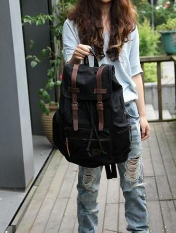 Casual Black Canvas Backpack with Adjustable Shoulder Straps for Work, School & Travel
