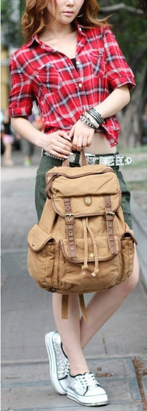 Woman carrying a light brown canvas rucksack backpack by SerBags