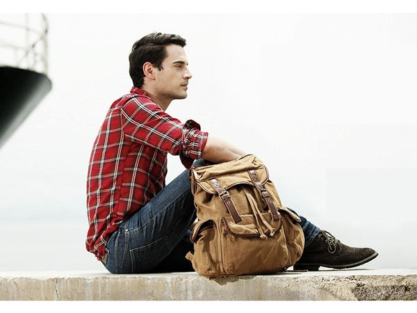 Man wearing a light brown canvas rucksack backpack
