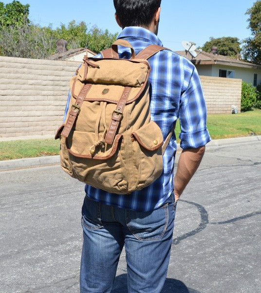 Man wearing the Serbags light brown canvas rucksack backpack