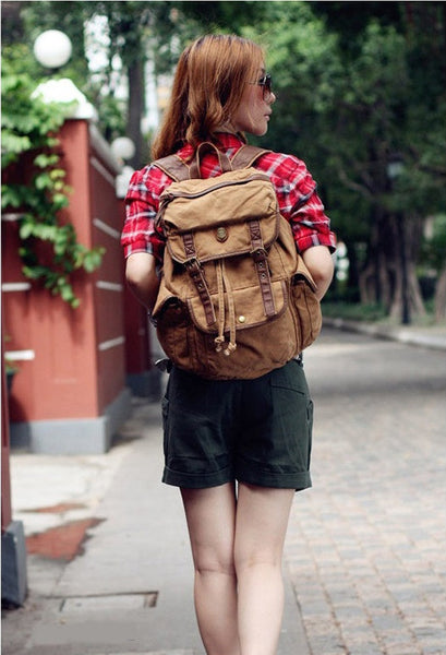 Woman wearing Serbags's light brown school backpack