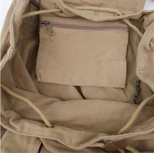 Interior lining of the Woman sporting the light-brown Classic Canvas Rucksack Backpack by Serbags