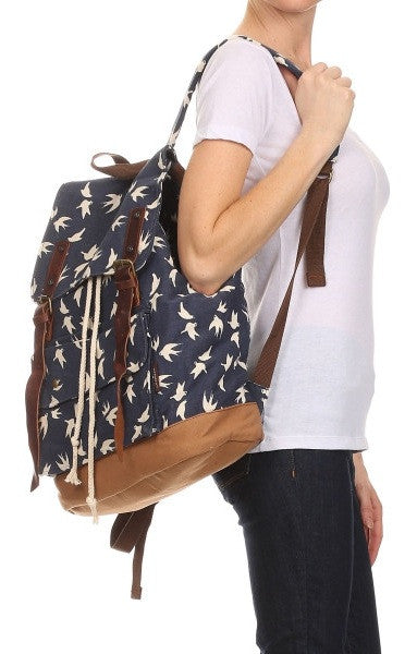 woman wearing the dove art print school rucksack for girls by Serbags