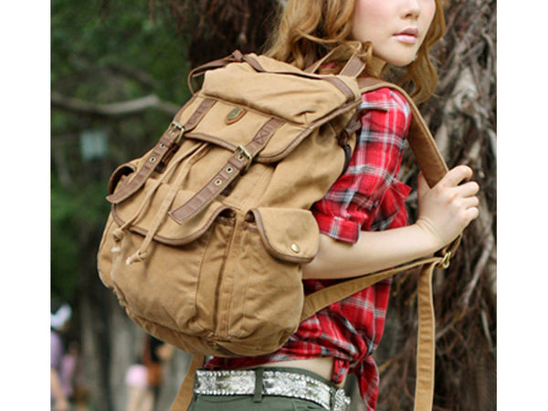 Woman wearing light brown canvas rucksack backpack by SerBags