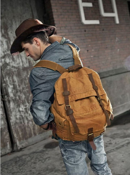 Sexy guy sporting the vintage brown Serbags canvas travel backpack