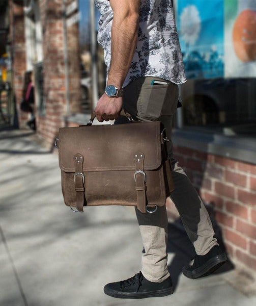 stylish man carrying the handcrafted distressed leather laptop briefcase by Serbags