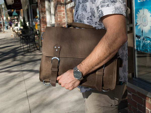 man wearing the handcrafted distressed leather laptop briefcase by Serbags