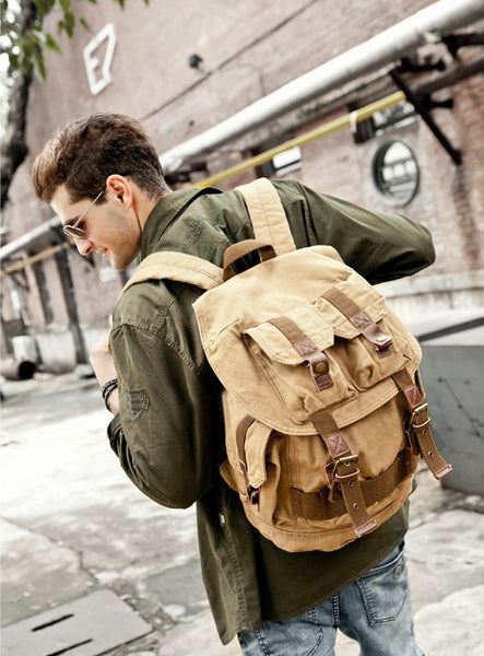 Stylish man wearing light-brown military travel backpack