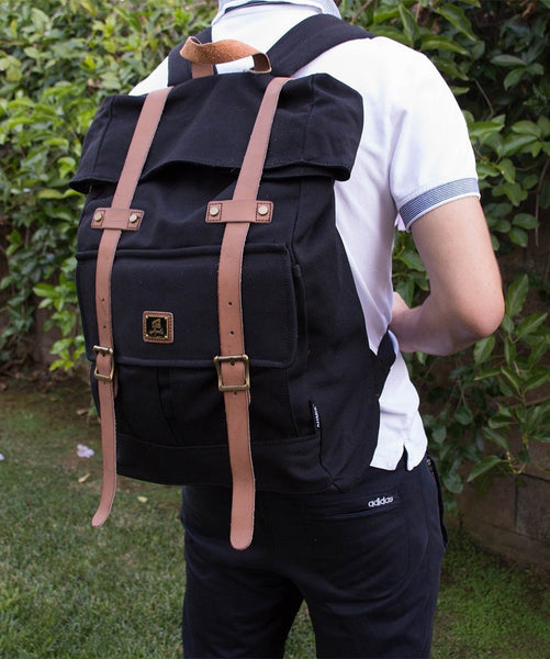 Man wearing Roll top vintage rucksack backpack by Serbags
