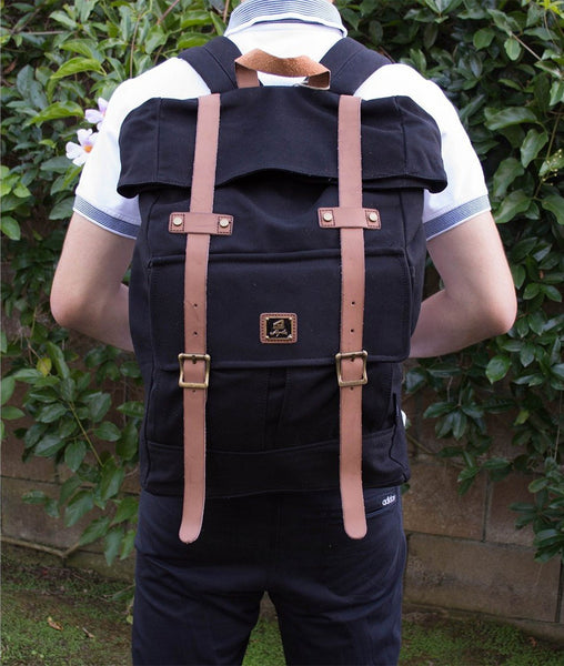 Guy sporting Roll top vintage rucksack backpack by Serbags