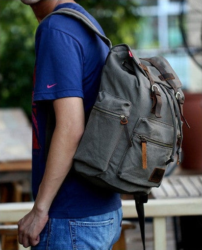 Stylish man wearing the casual canvas backpack by Serbags - side view