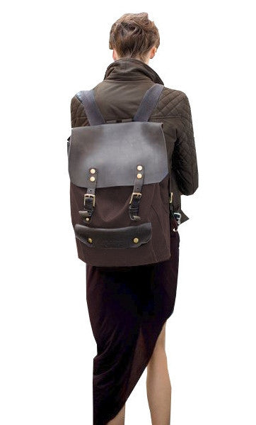 Woman wearing vintage casual canvas leather student backpack by Serbags