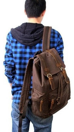 man wearing beautiful dark brown vintage canvas backpack by Serbags