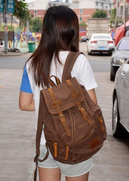 durable chocolate colored canvas backpack worn by girl