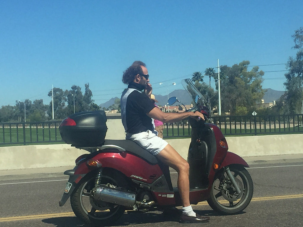 Random photo of guy on a moped in Scottsdale wearing penny loafers.