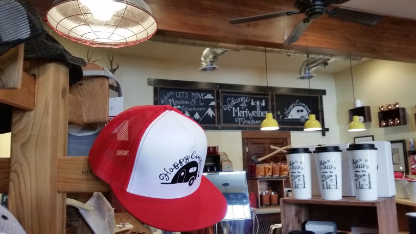 Happy Camper trucker hat inside our retail gift shop in Whitefish, Montana