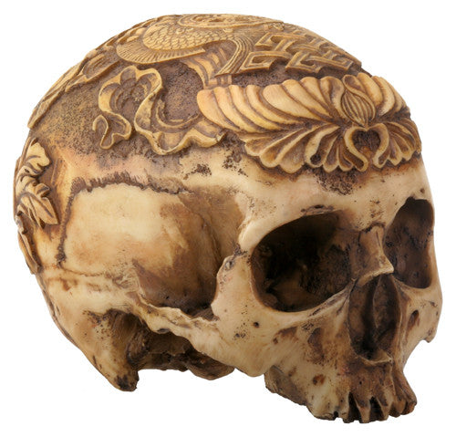 Decorative carved human skull decorative object