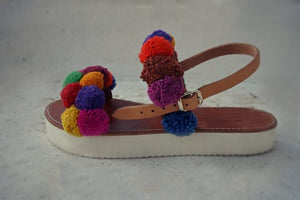 "Pompomized leather sandal handmade with a stylish white sole "" Oenone"""
