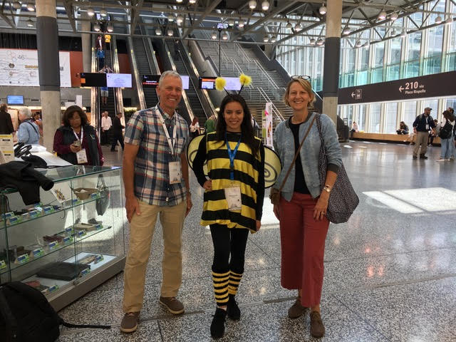 Mike and Shannon Everly with cute girl in bee costume at Apimondia