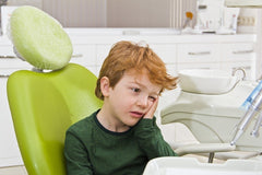 Worried child in dental chair