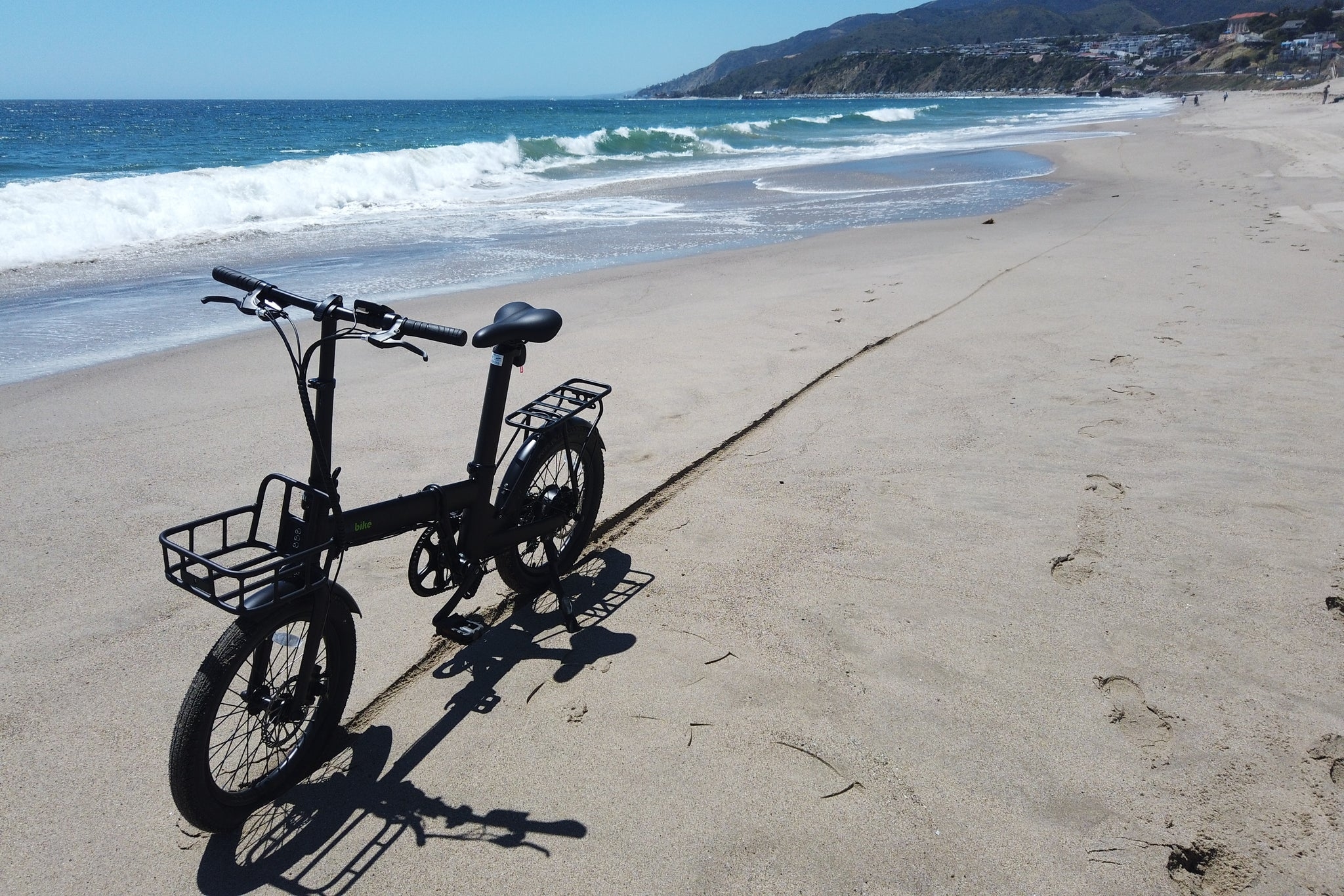 Qualisports Fodling Electric Bike Dolphin on the beach