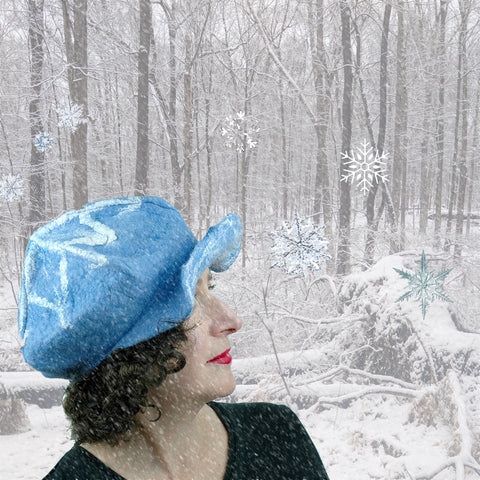 Digital Collage of Pale Blue Cap set against a snowy forest.