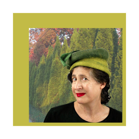 Leafy Green Hat against trees