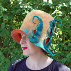 A summery colored Peapod hat in yellow, orange and green for Winterwear