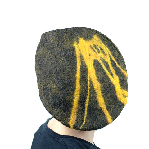 Back view of black-colored, felted flat top beret with gold-colored Pittsburgh bridge