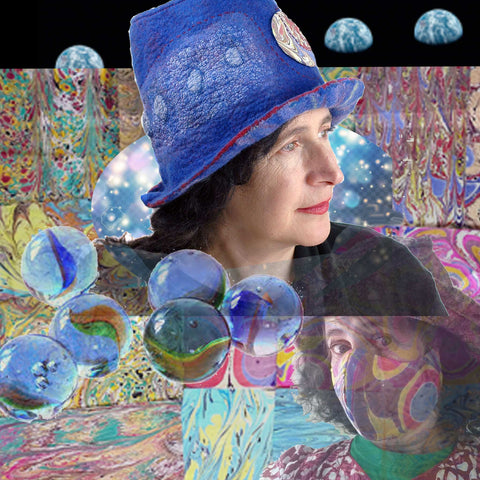 Blue Pilgrim Top Hat with Striped Brim set against a field of marbelized cotton fabric and glass marbles, with a backdrop of the famouse Earthrise photo behind me.