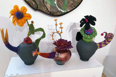 Three Ceramic Teapots with Wet Felted Floral Fantasy Stoppers on Top by Ellen Silberlicht