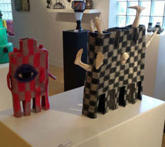 Two of Rae Gold's Felted Teapots on exhibition