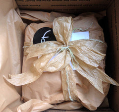 Gift Wrapped Hat with new recycled brown kraft tissue, paper crinkle ribbon bow and black FeltHappiness sticker. Plus, hand written card in envelope.