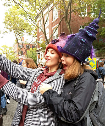 Two young women enjoying some of my felted wizard hats at RISDCraft
