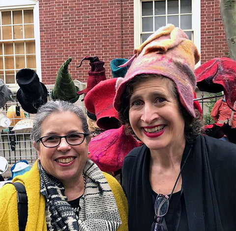Here I am wearing a warm peach hat borrowed from my shop. On my right, wearing a yellow coat, is my former weaving teacher art RISD, Susan Sklarek.