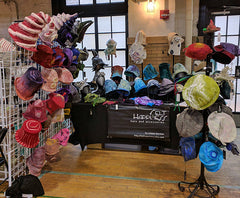 Booth of Felted Hats all ready to be tried on at the Indie Knit and Stitch at the Ace Hotel PGH