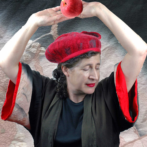 Woman wearing a vintage kimono and holding and apple. Red and Gray Felted Beret.