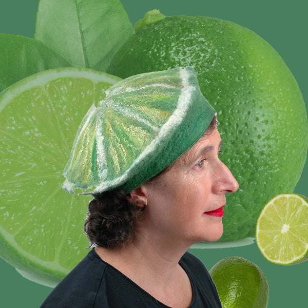 Slice of Lime Felted Beret Hat with collage of limes behind.