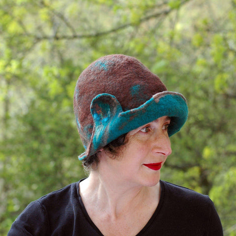 1920s Style Brown Felted Cloche with Emerald Green Brim - side view outdoors.