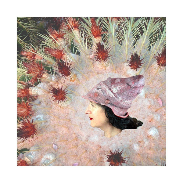 Hat digitally collaged on to the tip of a pink and red cactus.