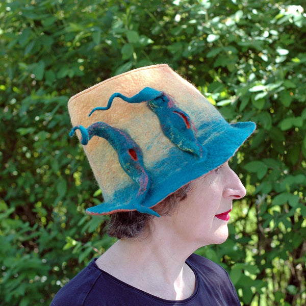 Almost Classic Yellow Fedora with Organic Shaped Pods- side view against green shrubs
