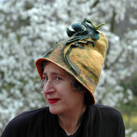 Big Tree Inspired Felted Hat - in front of blossoms