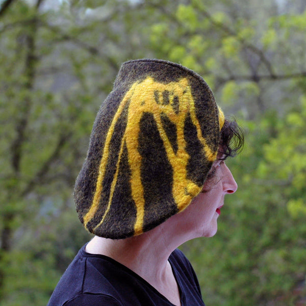 Black and Gold Beret with Bridge - with greenery behind