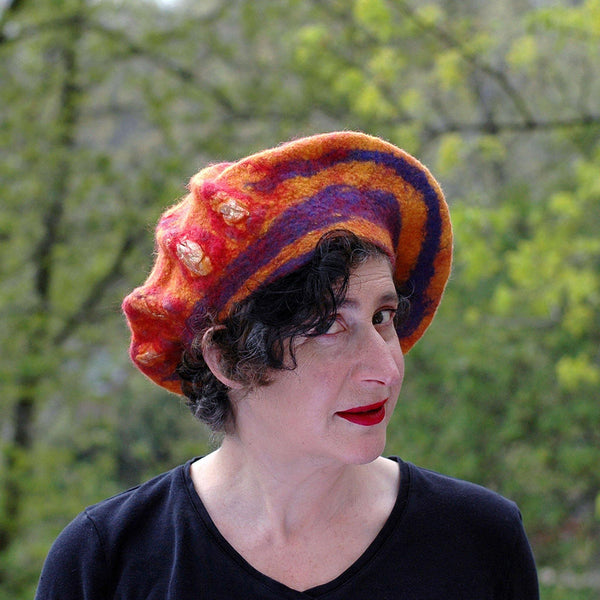 Circus-Style Yellow, Red and Blue Striped Beret against the trees